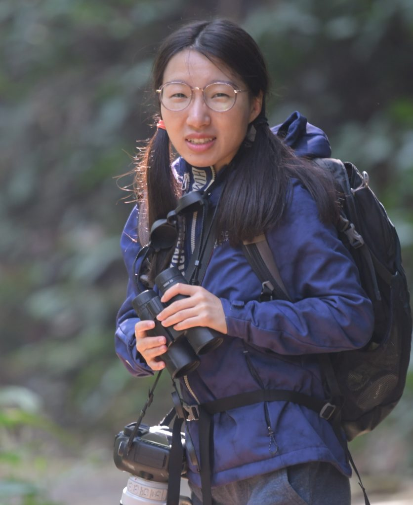 photo of liping zhou in the field