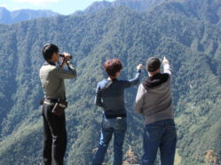 photo of researchers at mountain overlook