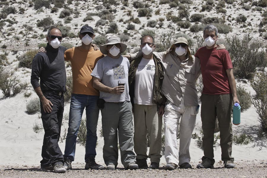 researchers wearing masks to protect themselves from dust and ash